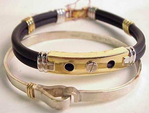 1011: Tiffany sterling and gold bangle bracelet and a