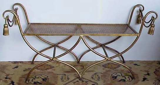 1030: Gilt metal window bench with tassel motif, 23  1/