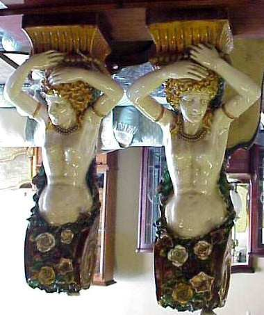 1172: Pair of majolica figural wall corbels with ladies