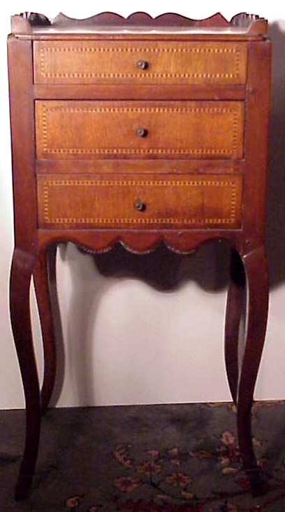 2025: French style inlaid mahogany stand, three drawers