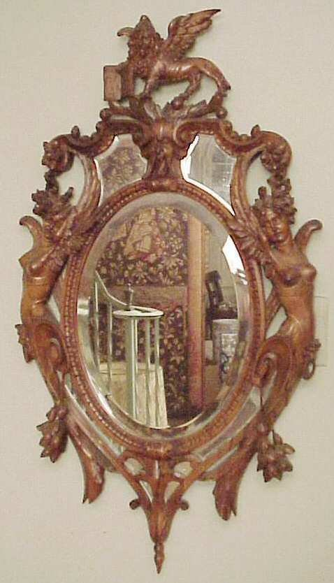2216: Italian style oval carved pear wood mirror circa