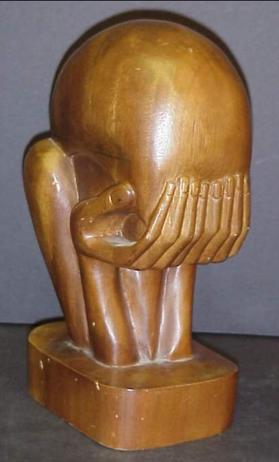 2001: Wood carved sculpture of a figure with head in  h