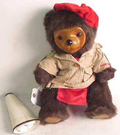 1023A: Carved wood and fur Teddy bear signed Robert Rai
