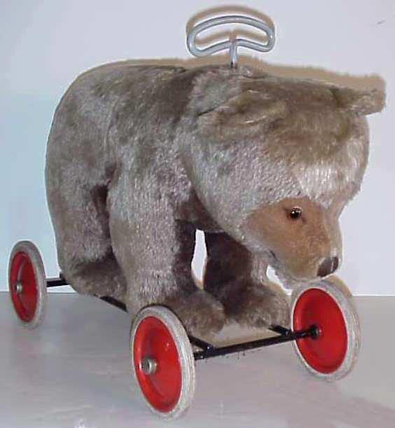 1198: Steiff riding bear, plush, missing one glass eye,
