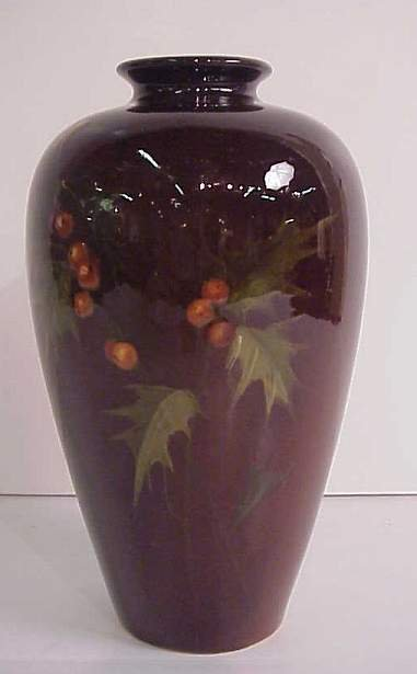 3017: Brown pottery vase with hand painted holly berry