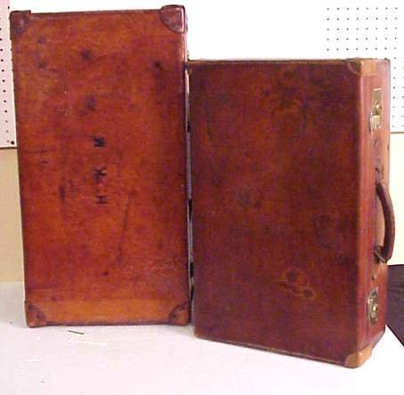3021A: Two vintage leather suitcases