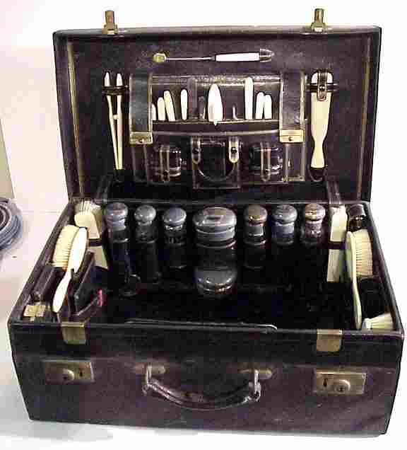 187: English leather cased sterling & celluloid travel