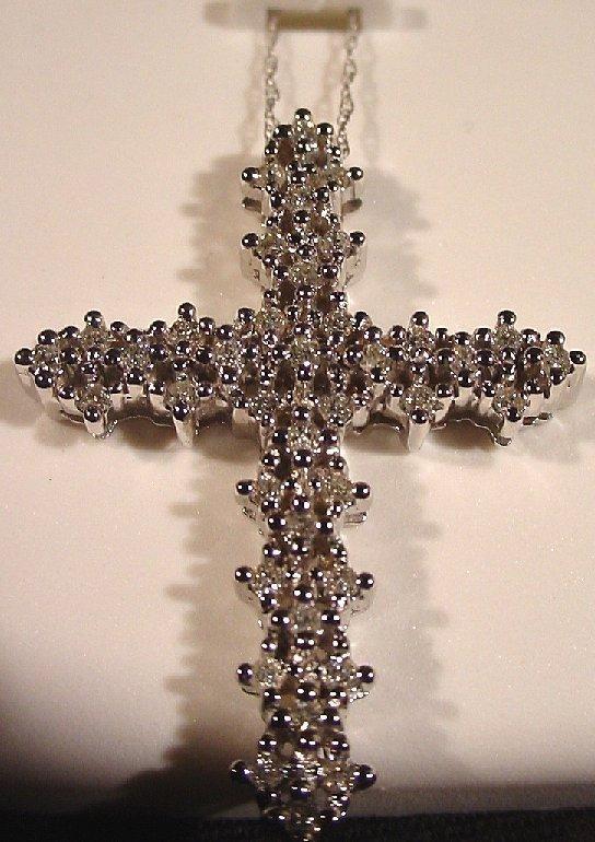 1007A: 14k gold and diamond cross pendant, .50ctw  diam