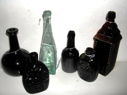 2008: Group of antique glass bottles, flasks and a  bit