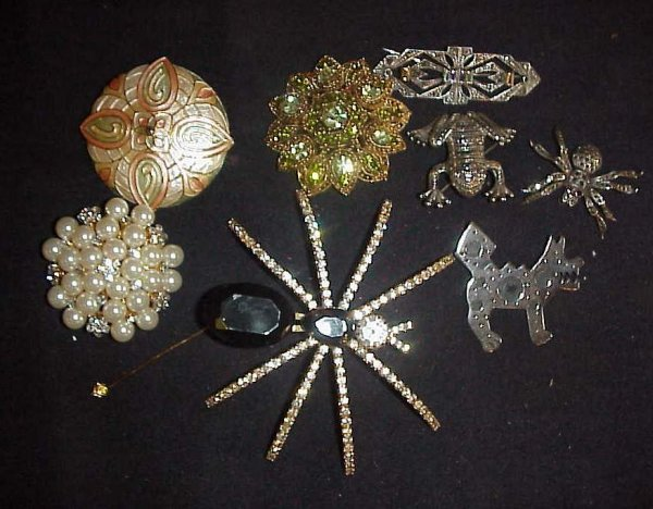 1019: Group of costume and sterling brooches includes