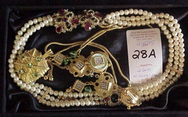 1028A: 2 costume jewelry earring and necklace sets, one