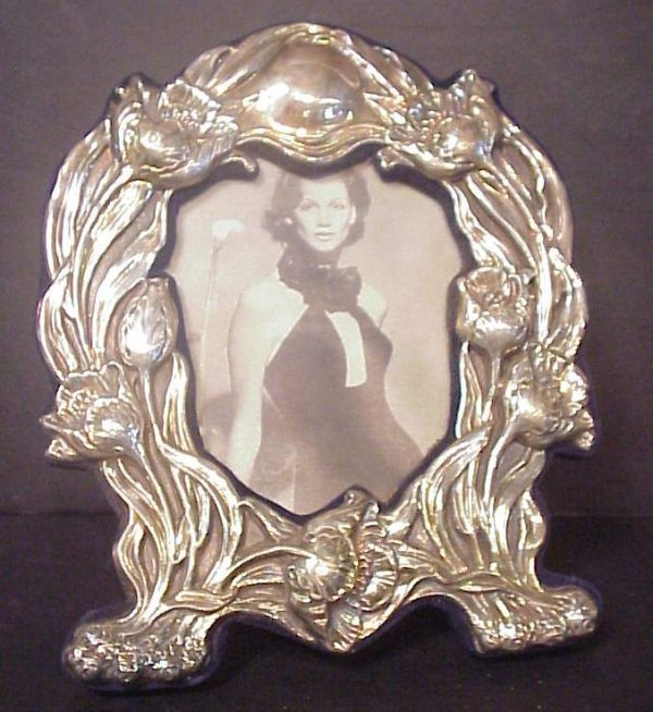 """3028: Sterling poppy repoussee picture frame 9 1/2"""" x 8"""