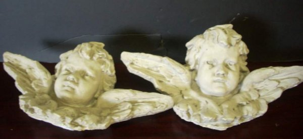 3032: Pair of ornamental cast plaster cherubs with  win