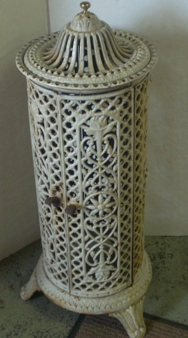"3020: Painted cast iron parlor stove, 31""h, 14""d"