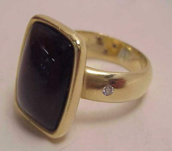 25A: 18k gold cabochon smoky topaz ring, marked with an