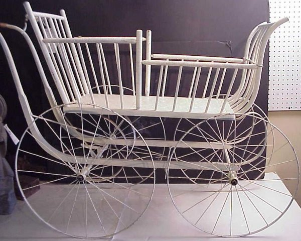 1015: Victorian baby carriage, wood with metal wheels,