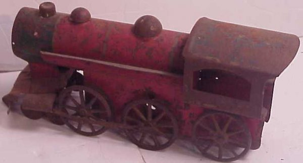 1024: Tin toy train engine, painted, as found, has rust