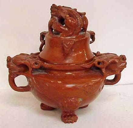 1003: ORIENTAL CARVED STONE COVERED JAR WITH DRAGON MOT