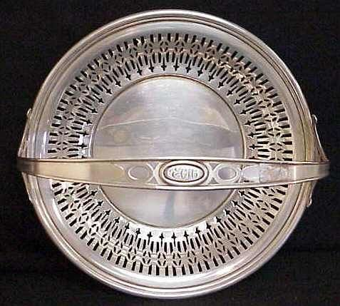 1025 A: STERLING SILVER RETICULATED BASKET WITH HANDLE,
