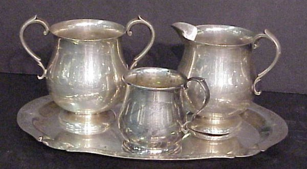 2026: 4 sterling pieces, sugar, creamer, small pitcher,
