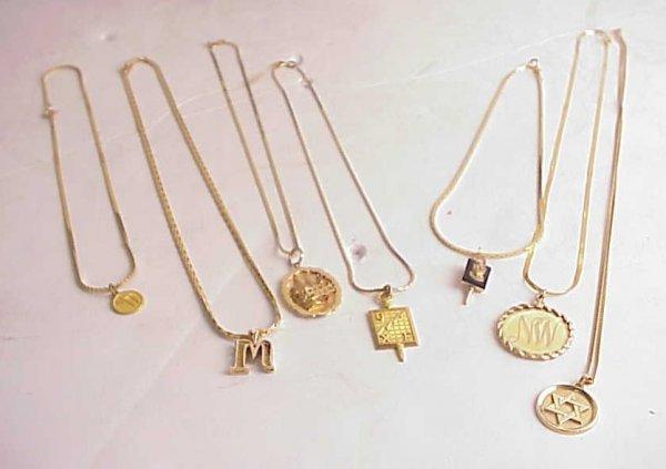 2025A: 7 14k gold chains, 3 14k pendants, gold bangle