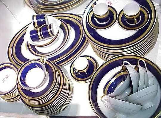 102A: ROSENTHAL,GERMAN COBALT & GILT RIM DINNER SERVICE