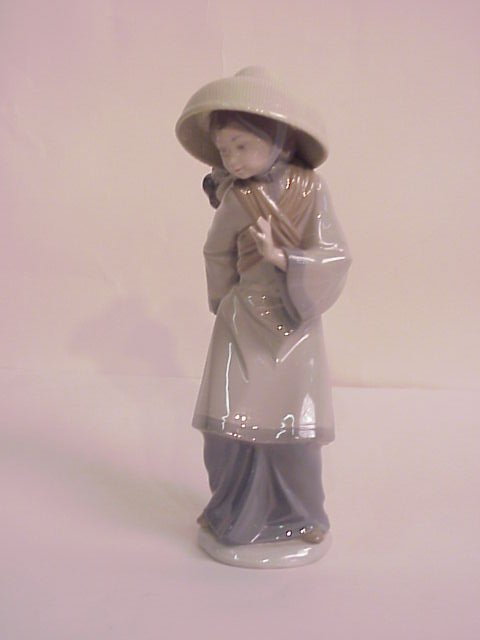 "12: Lladro Asian mother with baby figure, 10 1/2""h x  4"