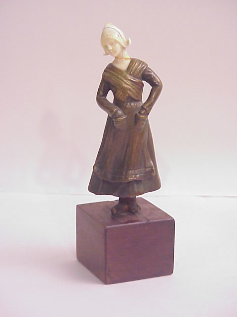 22: Bronze and ivory figure of a Dutch girl, head is  g