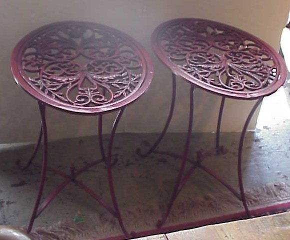 20: Pair of painted iron garden tables