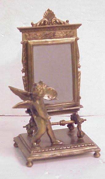 "1014: French style bronze cherub mirror 9 1/2"" x 4 1/2"""