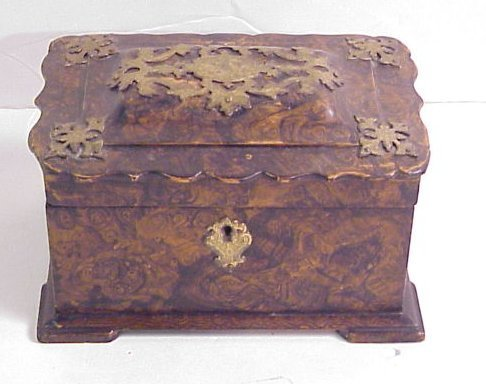 1013: 19/20thc faux painted teacaddy with brass mounts
