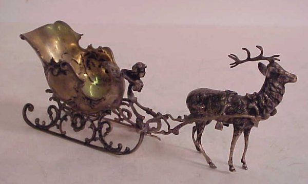 3022: Continental silver sleigh and reindeer 12 ounces,