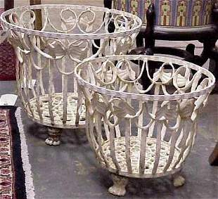 TWO VINTAGE WROUGHT IRON PLANTERS WITH PAW FEET