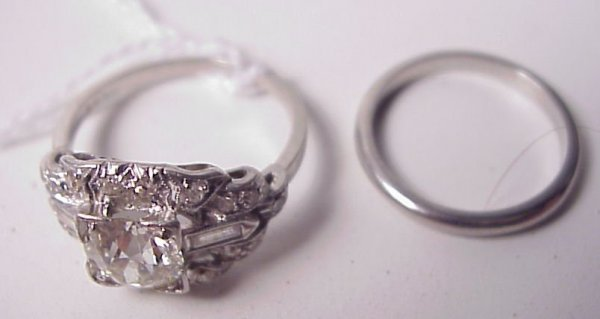 181: Two Platinum ladies rings, one is set with center
