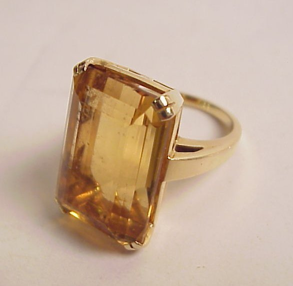 10A: Large emerald cut topaz ring in 14k gold setting,