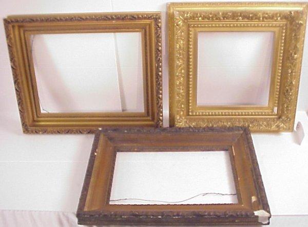"1001: Three antique hand carved gilt wood frames, 24"" x"
