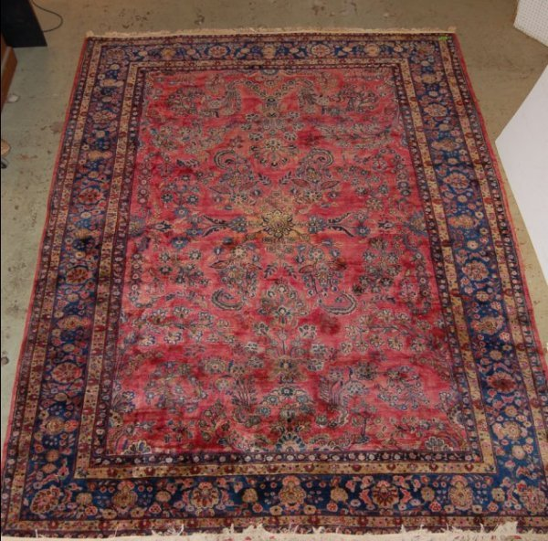 2063: Semi antique Sarouk carpet red ground 9' x 12'3""