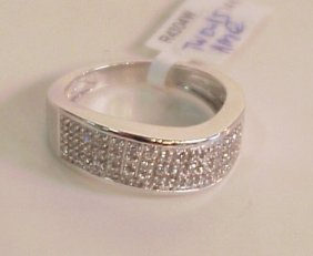 2015A: 14k white gold and diamond ring, 0.15 ctw