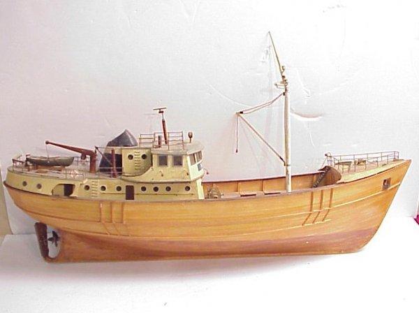 "3015: Nordkap boat model, wood with motor, 17""h x 32""w"