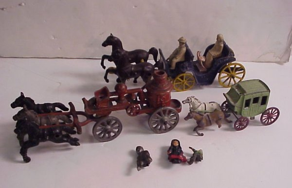 4014A: Tree early iron toy wagons and carriages, some