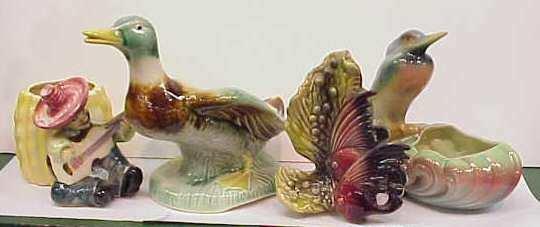 3006: SIX  POTTERY FIGURAL PLANTERS,DUCK,BIRD,