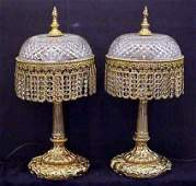 3166 A PAIR OF GILT METAL AND CRYSTAL TABLE LAMPS 26