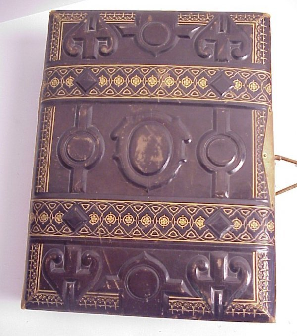32: Victorian photo album filled with Cabinet photos  a