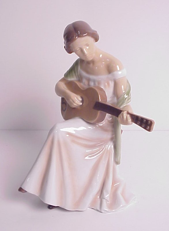 "6: B&G figure of a woman playing a guitar 10"" x 7  1/2"""