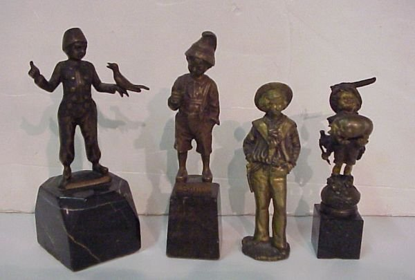 "26: 4 bronze figures of boys, ""Senn"" on marble base,"