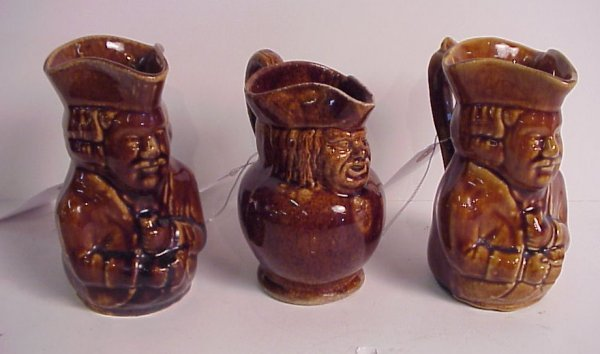 11: 3 figural Bennington style pottery pitchers,  unmar