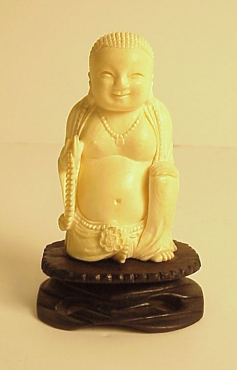 """29: Carved ivory Buddha, 3 3/4""""h, on wooden base 5""""h"""