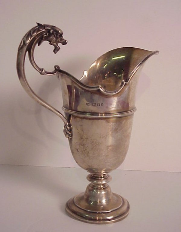 119: English sterling silver footed water pitcher  w/fi