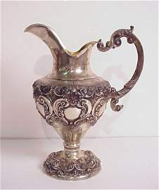 116: Ornate sterling silver water pitcher, marked .925