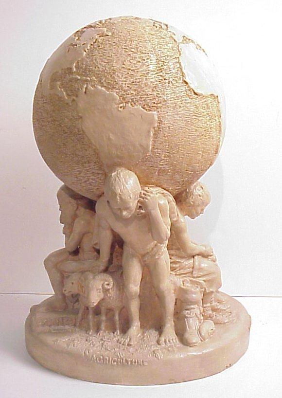 12: World' Fair Expo sculpture, pottery globe held up
